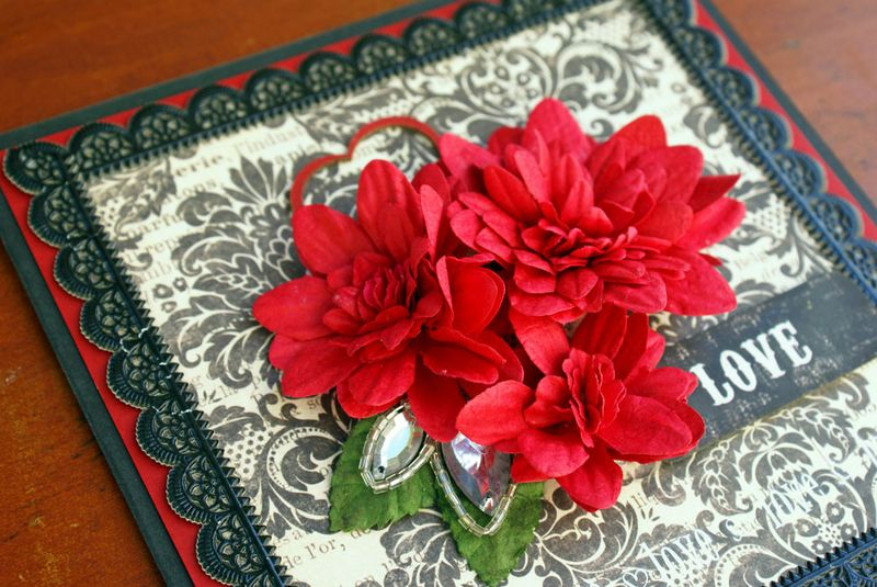 Card with red petals close up